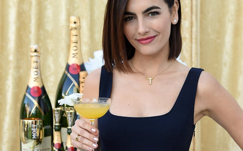 BEVERLY HILLS, CA - DECEMBER 13:  Camilla Belle poses with the signature cocktail for the 2019 Golden Globes, The Moet Belle, on display at the 76th Golden Globe Awards Show Menu Unveiling at The Beverly Hilton Hotel on December 13, 2018 in Los Angeles, California.  (Photo by Michael Kovac/Getty Images for Moet & Chandon)