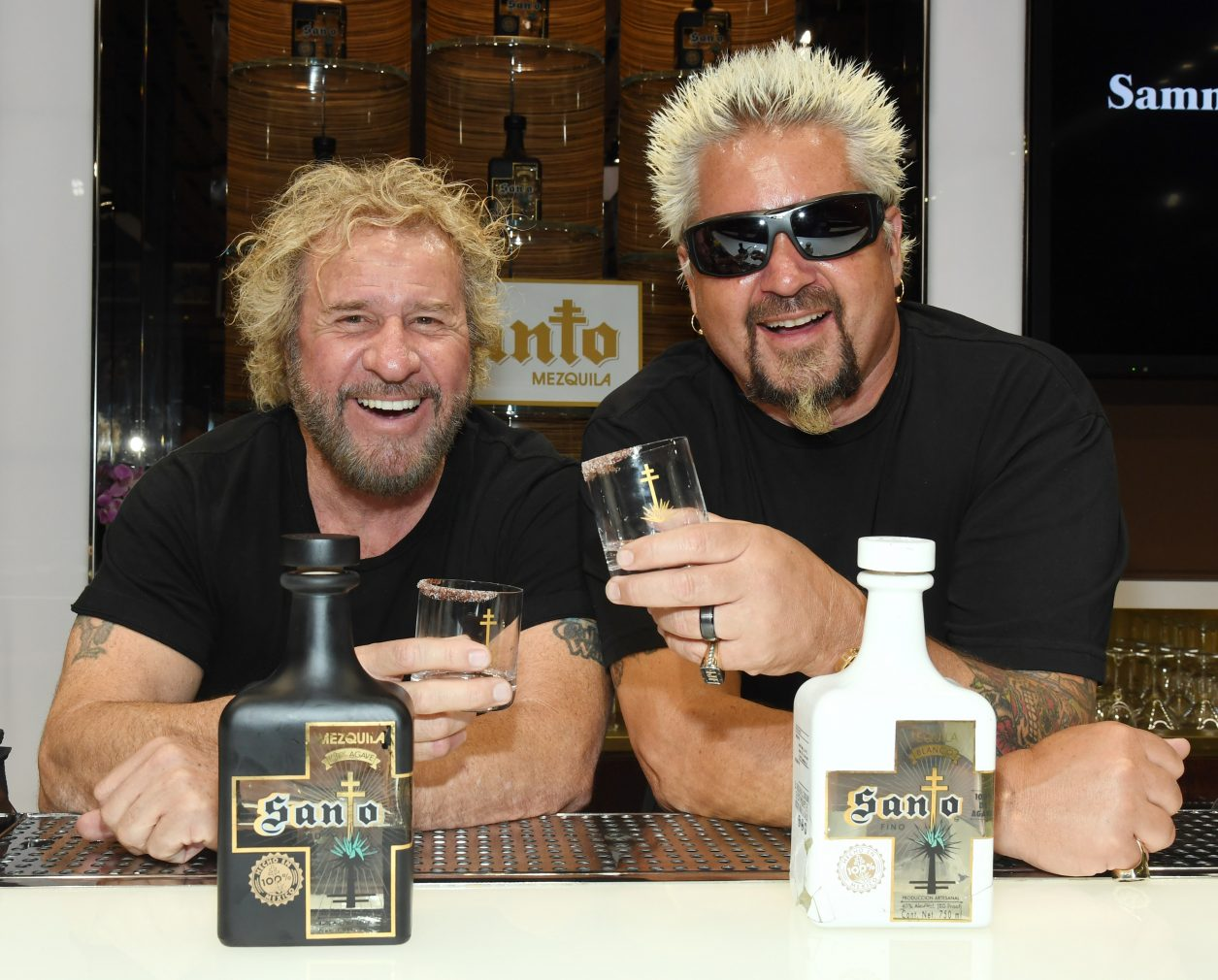 LAS VEGAS, NEVADA - APRIL 04:  Rock & Roll Hall of Fame inductee Sammy Hagar (L) and Emmy Award-winning chef and television personality Guy Fieri pose during the announcement of their partnership with Los Santo and Santo Puro Mezquila, in addition to the launch of Santo Fino Tequila at Southern Glazer's Wine & Spirits on April 4, 2019 in Las Vegas, Nevada.  (Photo by Ethan Miller/Getty Images for Los Santos: Santo Puro Mezquila)